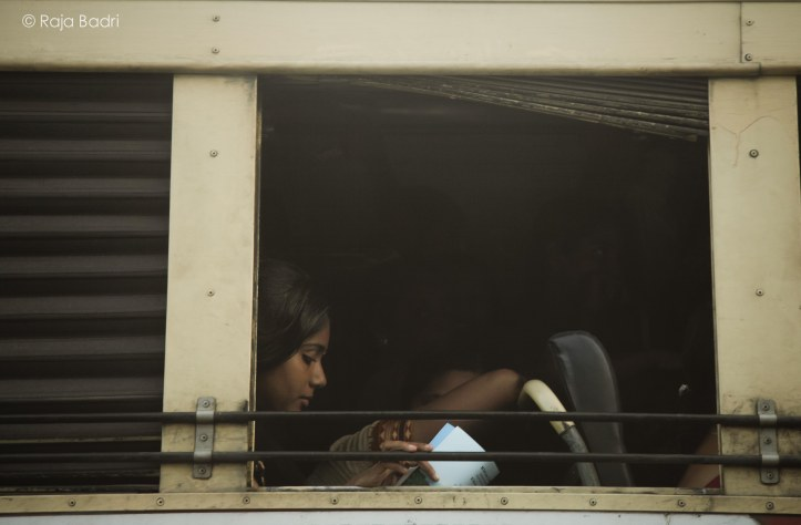 Girl reading in the bus